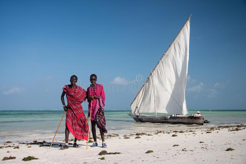 Two masai men in traditional clothes posing on the beach, Kiwengwa, Zanzibar. KIWENGWA, ZANZIBAR - DEC 27, 2017: Portrait of masai men in traditional clothes stock images