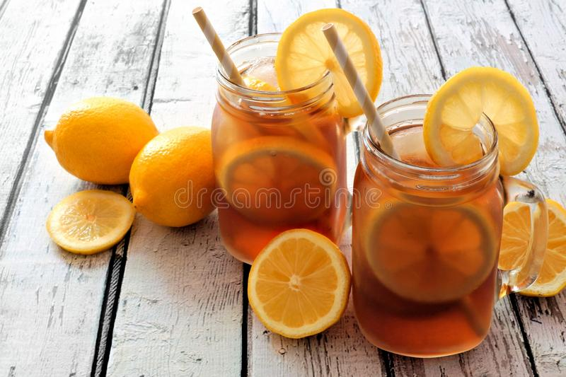 Download Two Mason Jar Glasses Of Iced Tea On Rustic White Wood Stock Photo