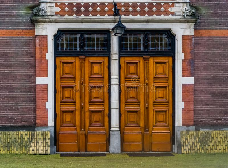 Two massive wooden doors with a lantern, Modern architecture, entrance door royalty free stock photo