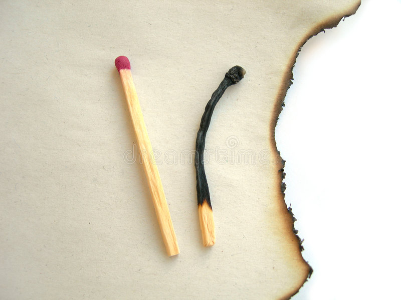 Two matches, burnt paper royalty free stock images
