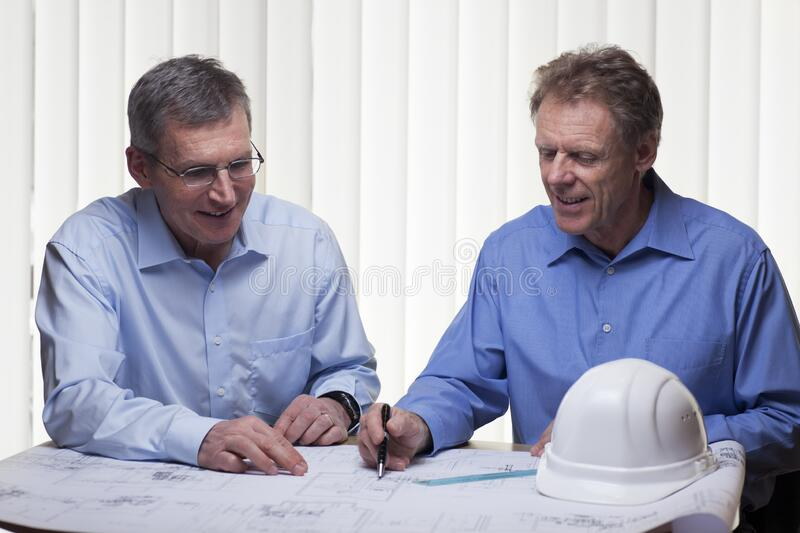 Two mature architects or engineers planning a project royalty free stock photos