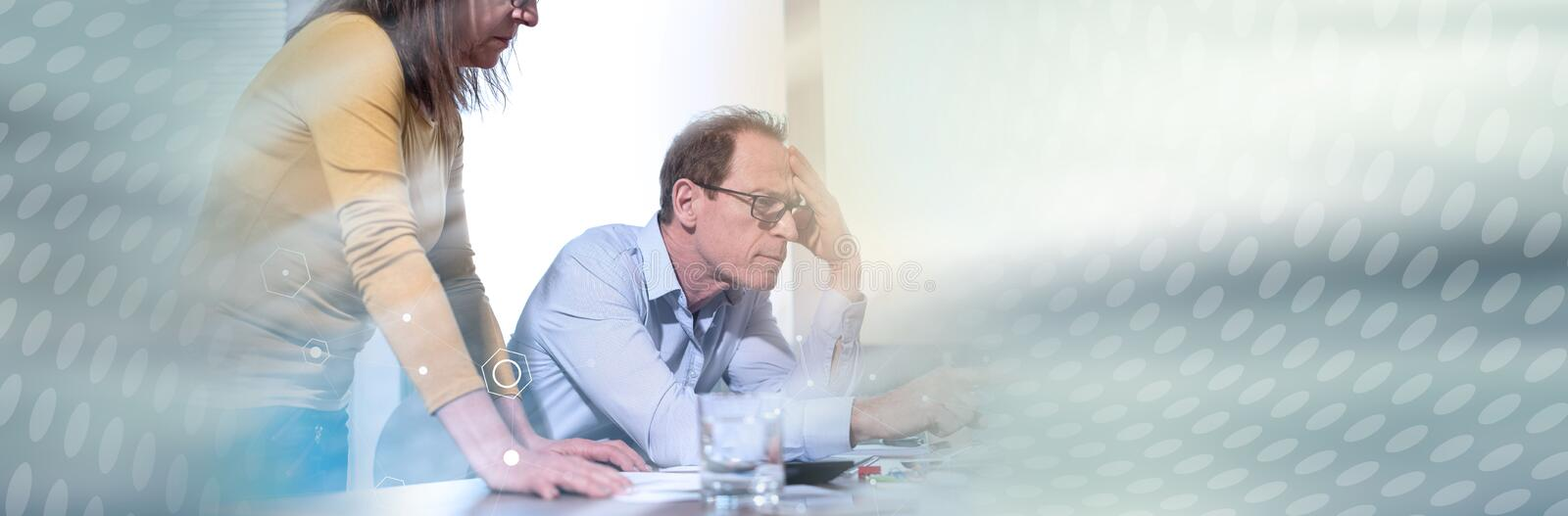 Two mature business people working together, light effect. panoramic banner royalty free stock image