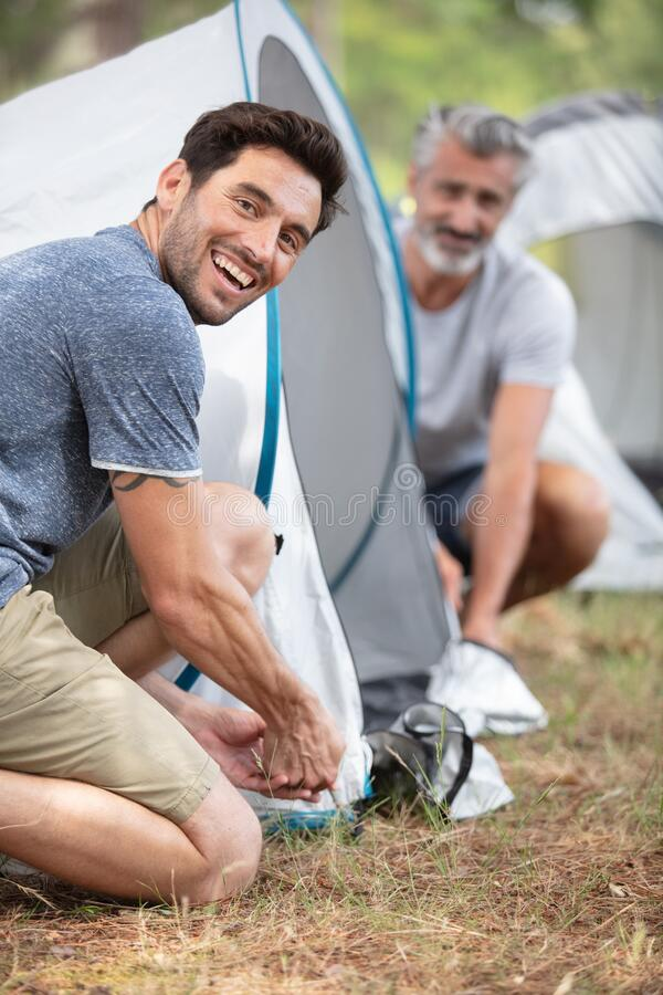 Free Two Mature Men Erecting Tent Royalty Free Stock Images - 202176589
