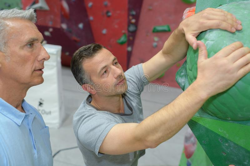 Two mature rock climbers royalty free stock image