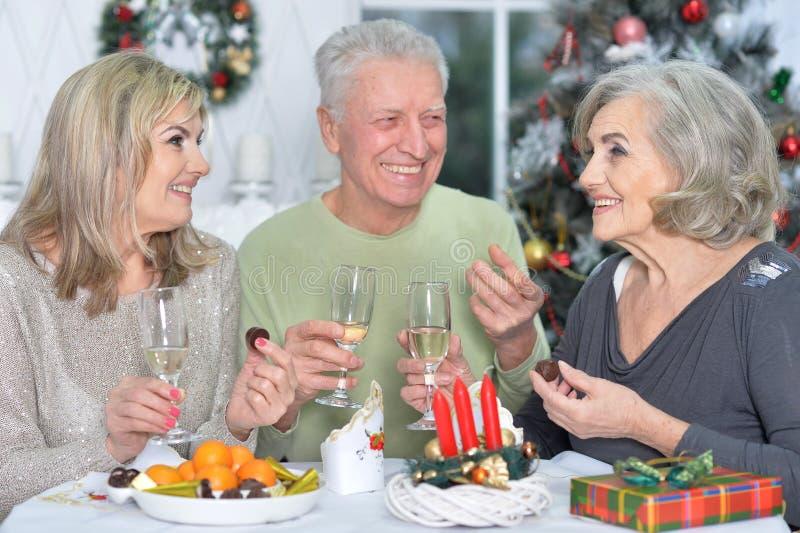 Two mature women and man. Two mature women and men celebrating new year royalty free stock photos