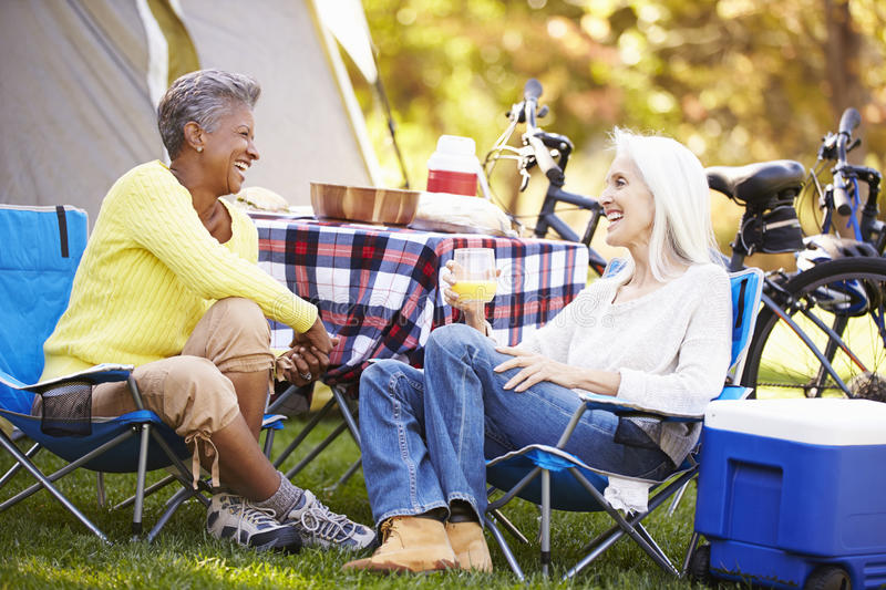 Two Mature Women Relaxing On Camping Holiday royalty free stock photo