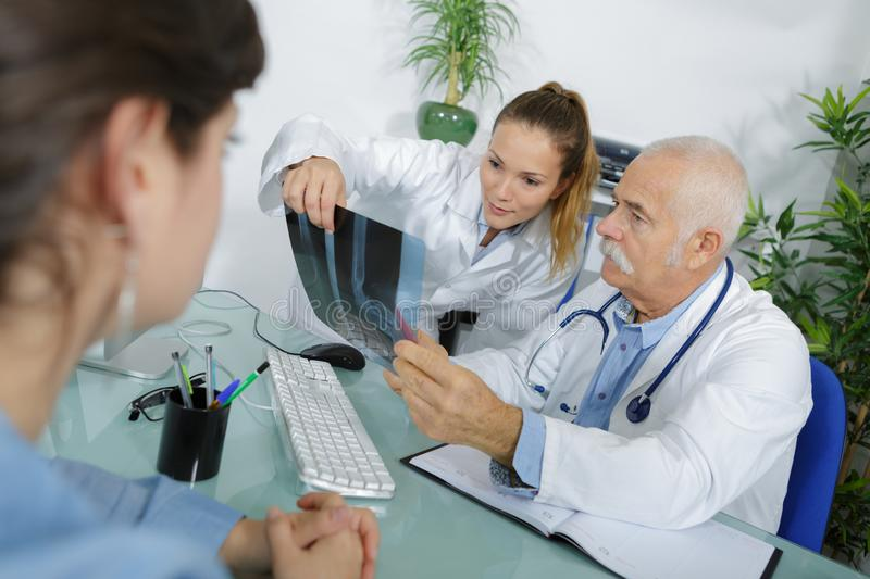 Two medical workers looking at xray stock photo