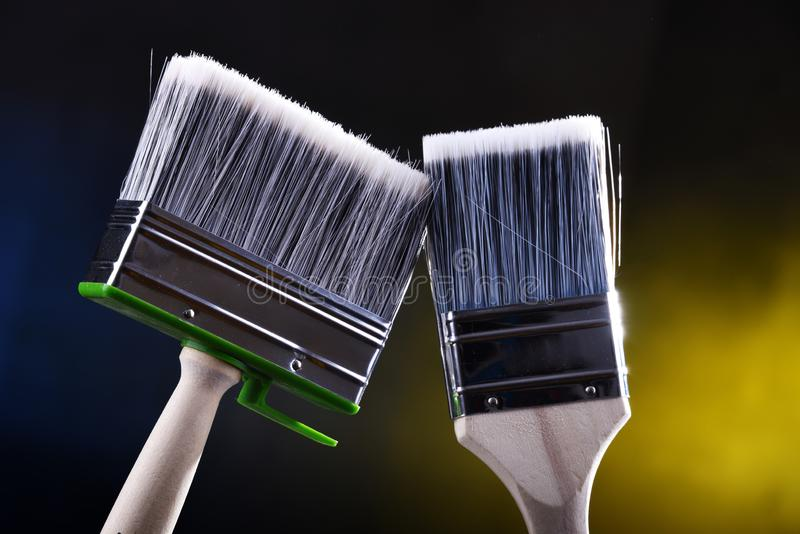Two medium size paintbrushes for home decorating purposes.  stock photography
