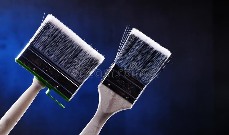 Two medium size paintbrushes for home decorating purposes royalty free stock photography