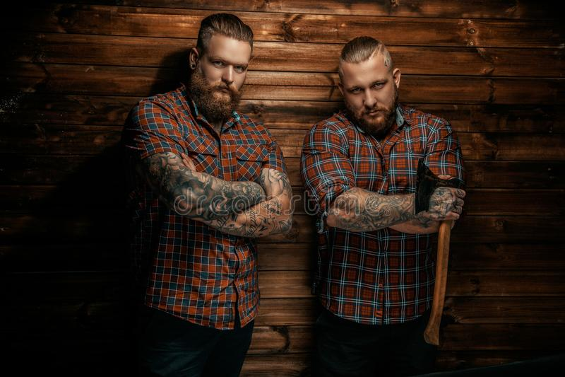 Two men with beards and tattoo. stock photos