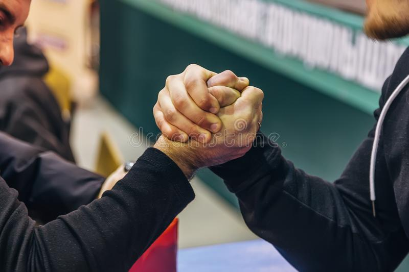 Two men competing in arm wrestling. Two men competing in amateur arm wrestling stock images