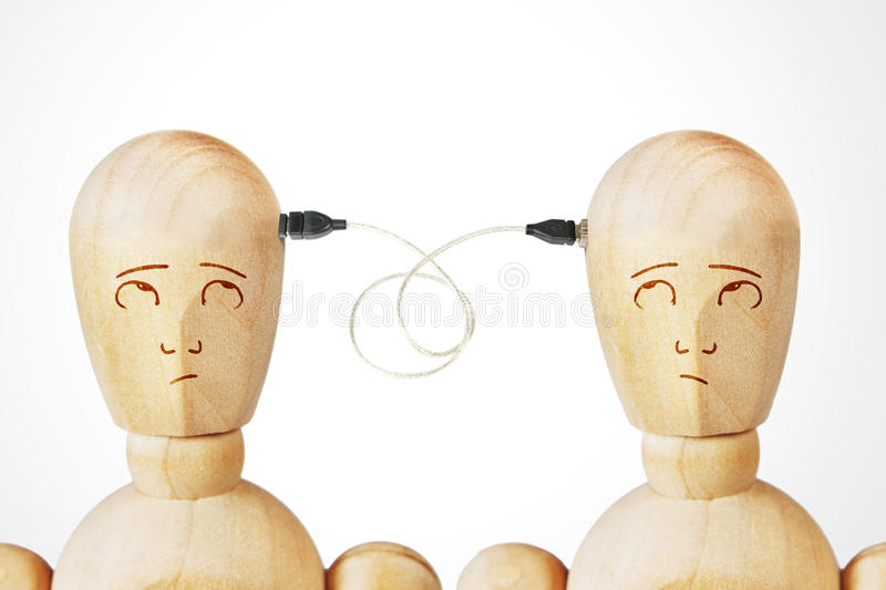 Two men connected with usb cable royalty free stock images