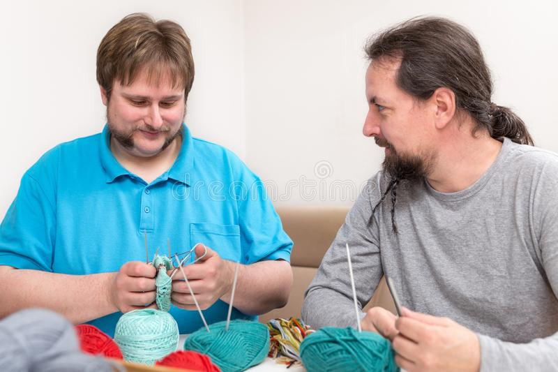 Two men are crochet together. At home royalty free stock photography