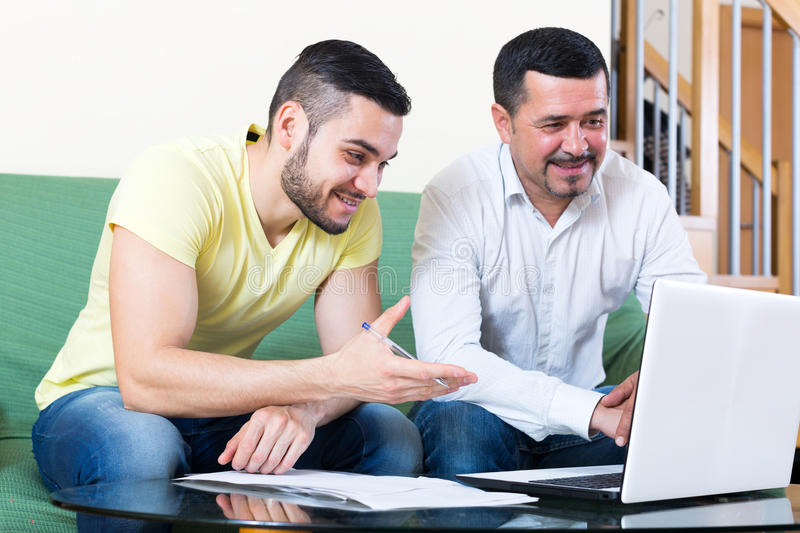 Two men with documents stock photos