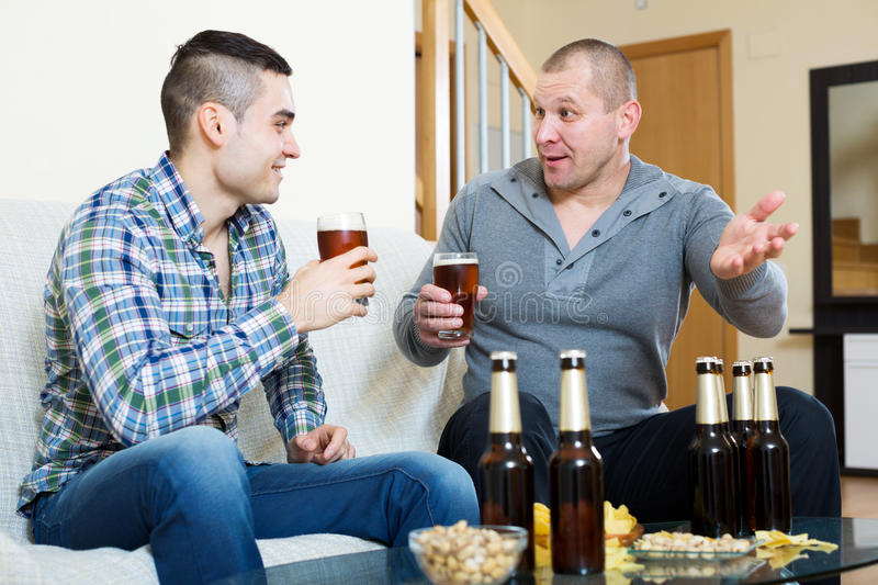 Two men drinking beer stock photos