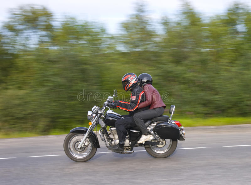 Two men drive on moto royalty free stock photos