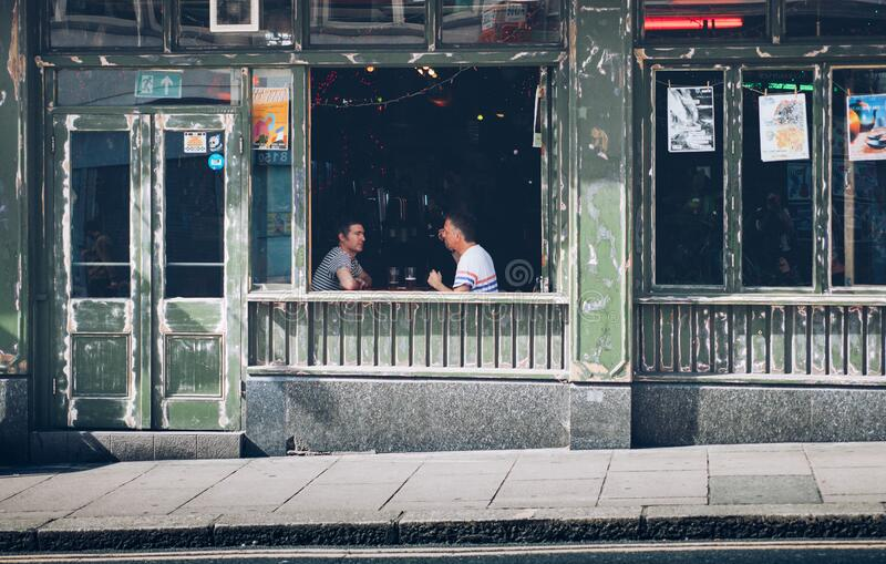 Two Men Eating While Facing Each Other Inside Store Free Public Domain Cc0 Image