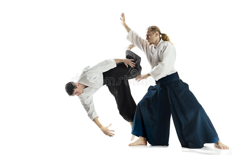 The Two Men Fighting At Aikido Training In Martial Arts School Stock