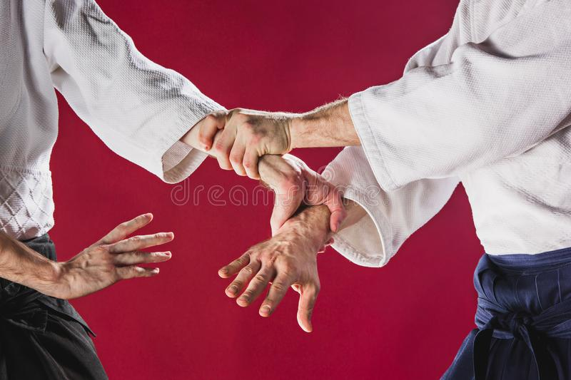 Two men fighting at Aikido training in martial arts school stock photos