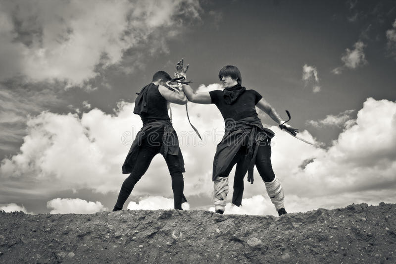 Two men are fighting stock photo