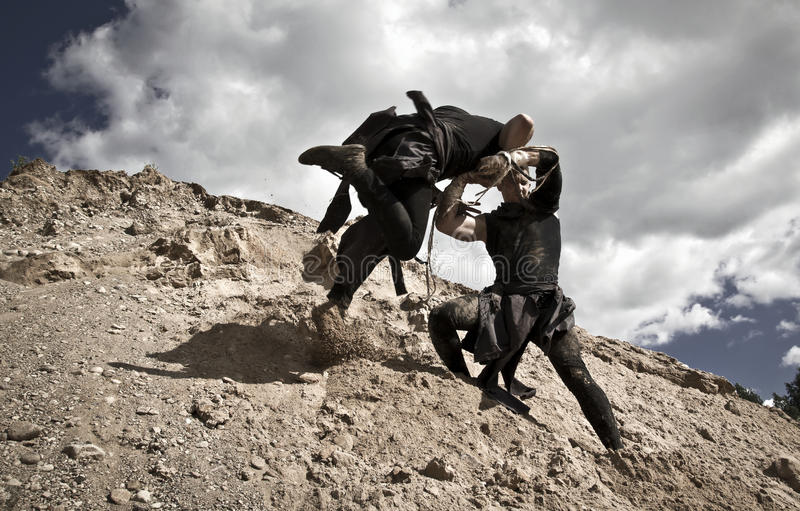Two men are fighting royalty free stock photography