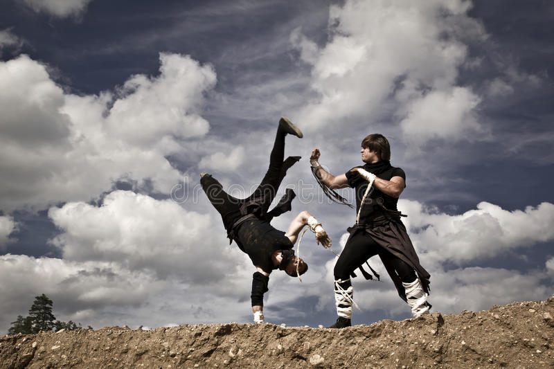 Two men are fighting stock images