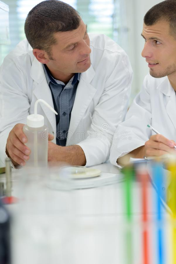 Two men in filtering laboratory royalty free stock photo