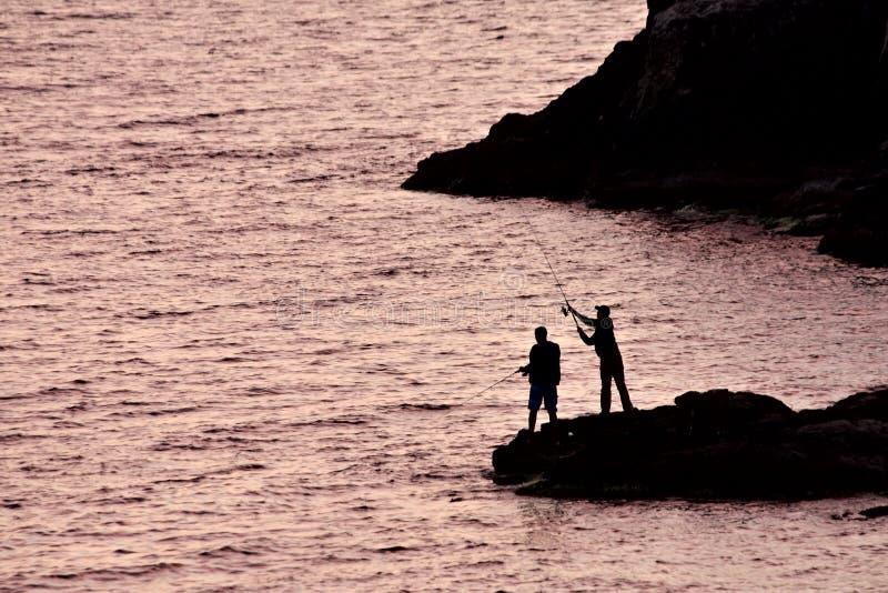 Two men fishing royalty free stock photo