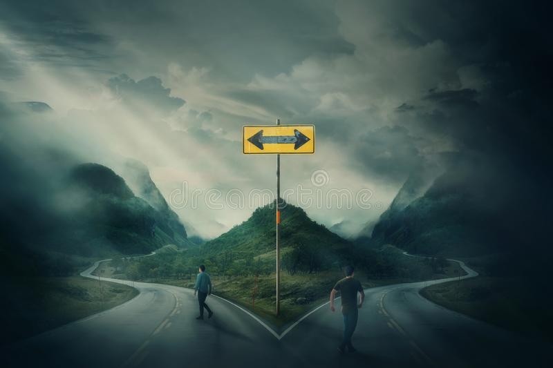 Two men going different roads as crossroad fork junction split in peculiar ways royalty free stock photos