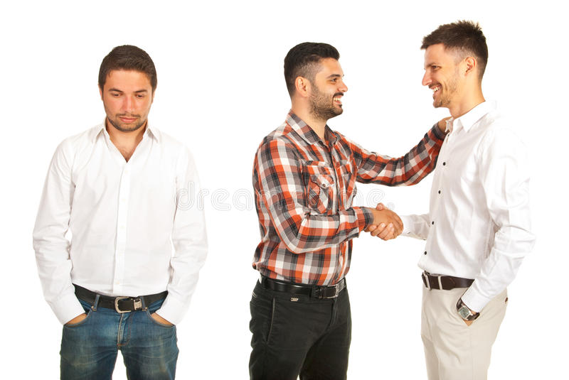 Two men handshaking and one it is disappointed stock photography