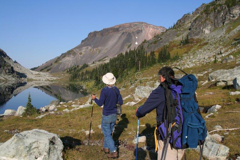 Two Men Hiking At Ring Lake Royalty Free Stock Image
