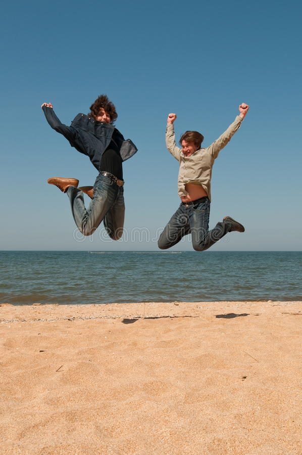 Download Two men in a jump. stock image. Image of pleasure, coast - 14968671
