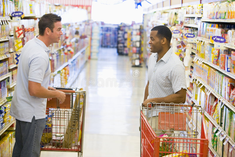 Two Men Meeting In Supermarket Stock Photo