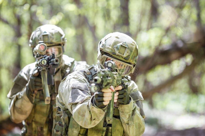 Two men on military operation stock photos