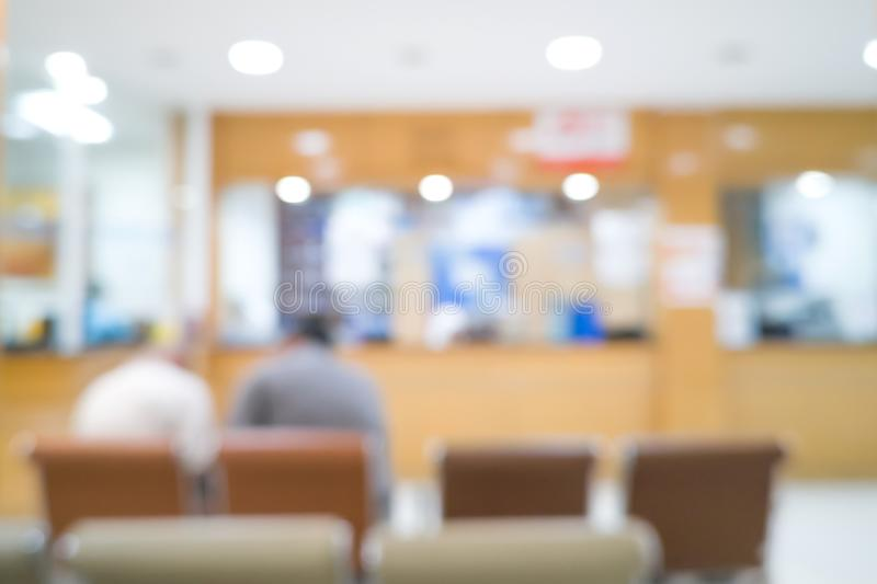 Two men patients waiting at Pharmacy. Blured background of healthcare. royalty free stock photo