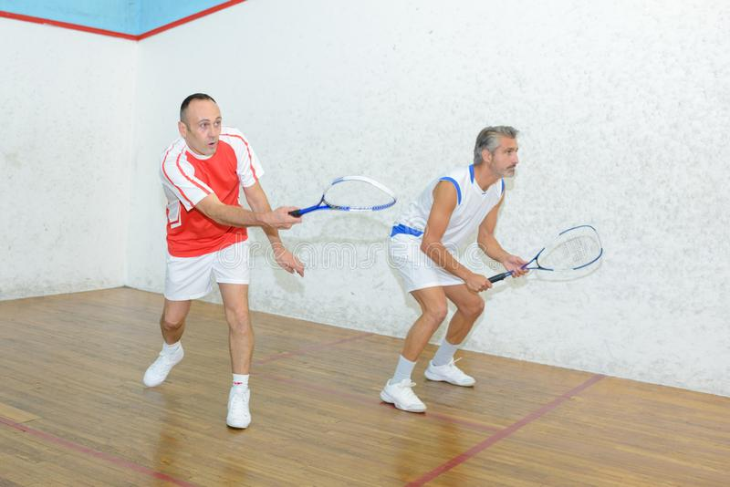 Two men playing squash stock photography