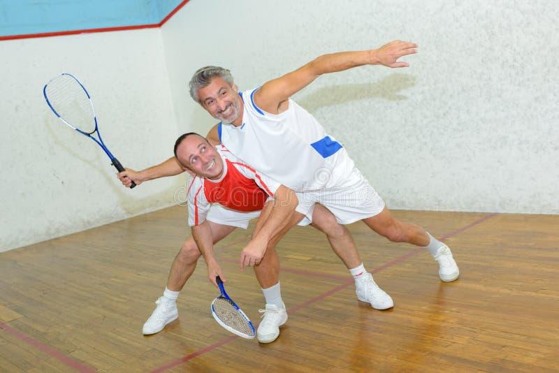 Two men playing squash. Squash stock images