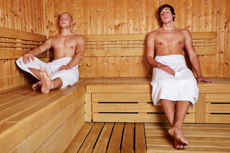 Two men relaxing in sauna