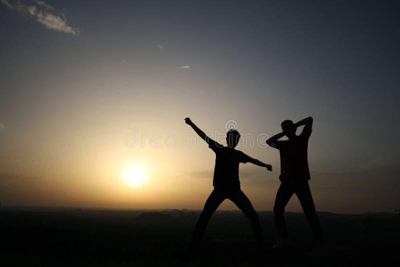 Two men's silhouette royalty free stock photo