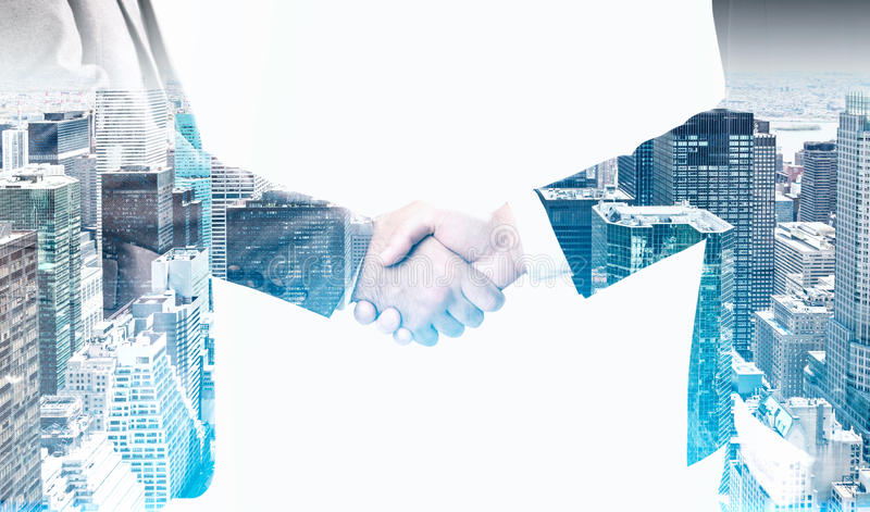 Download Two Men Shaking Hands In A City Stock Photo - Image: 83722144