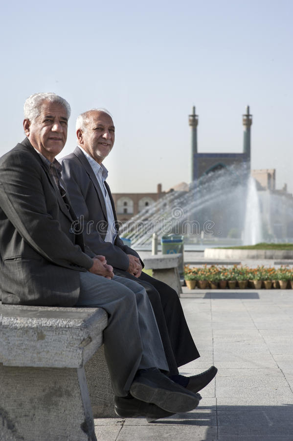 Two men sitting on Imam Square,Isfahan stock images