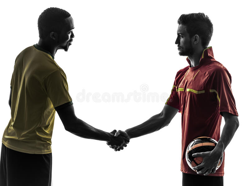 Two men soccer player handshake handshaking silhouette royalty free stock image