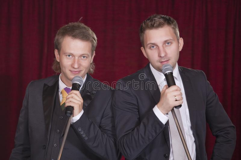 Two men on stage royalty free stock photos