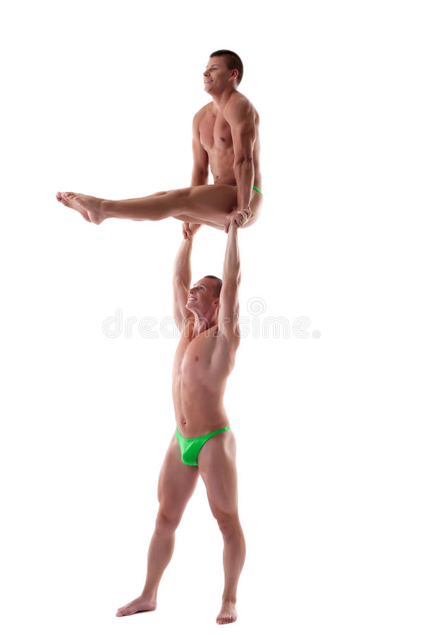 Two Men Stand On Heavy Gymnastic Performance Royalty Free Stock Photo