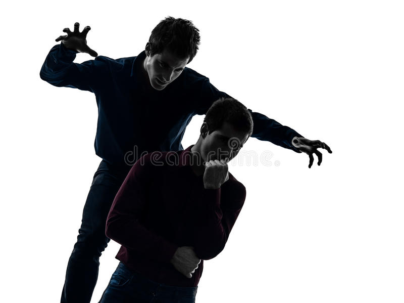 Two men twin brother friends domination schyzophrenia concept s. Two caucasian young men domination concept shadow white background royalty free stock image