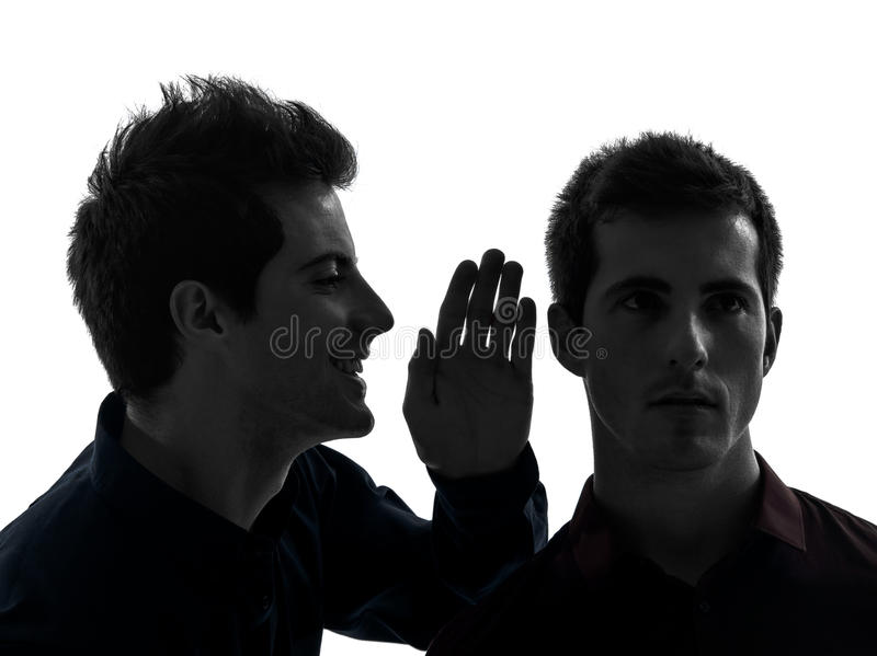 Two men twin brother friends influence concept silhouette. Two young men influence concept in shadow white background royalty free stock images