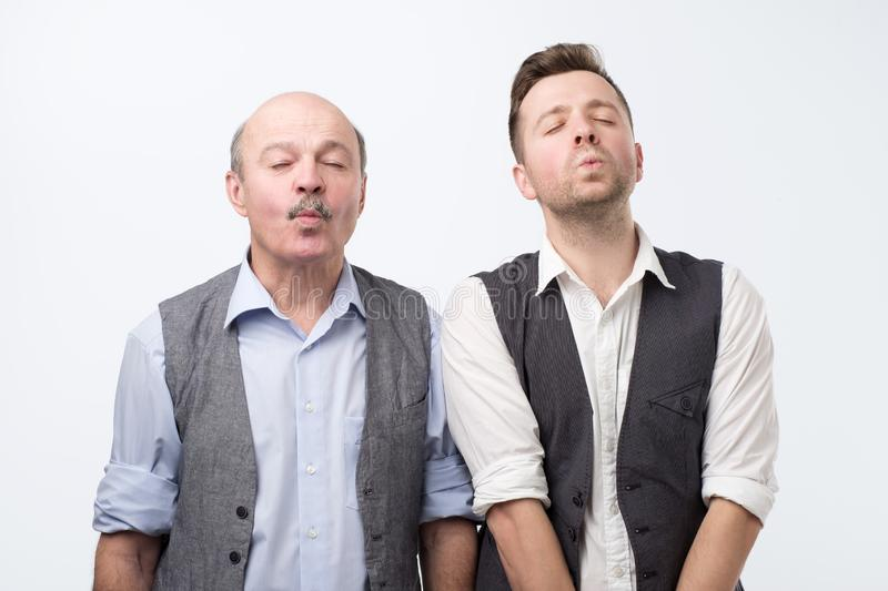 Two men, waiting for kiss closing eyes stock photography