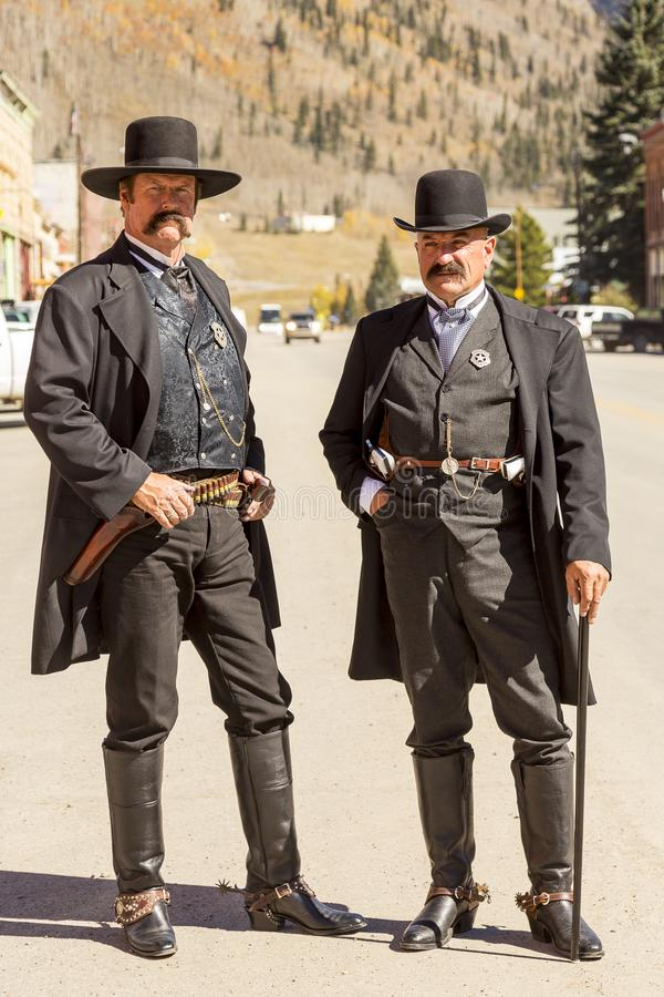 Free Two Men Wearing Moustaches And Vintage Old West Sheriff Outfits Stock Images - 114044874