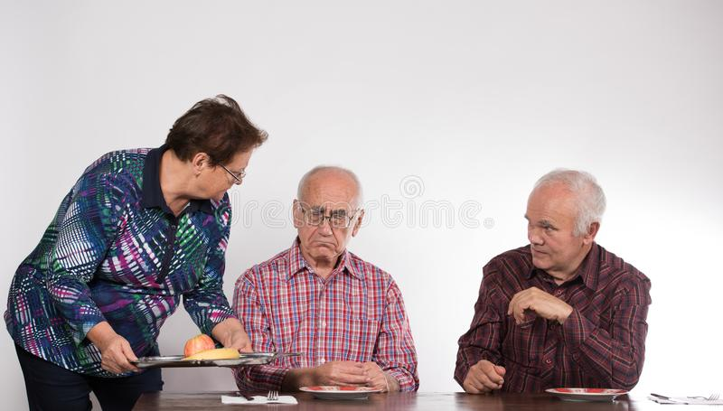 Two men and woman stock image