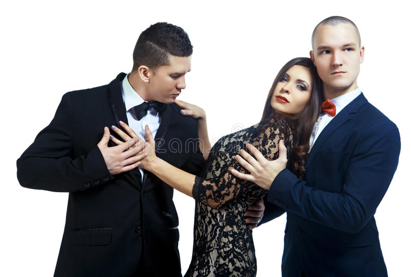 Two men and a woman royalty free stock image